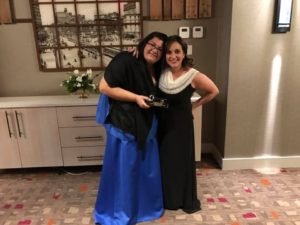 Christina (L) and our VP of Clinical and Youth Services Marisa Nicely pose with the well-deserved award!